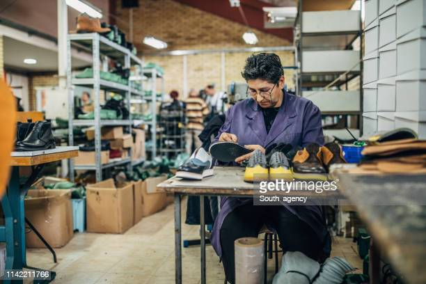 mature woman making shoe - shoe factory stock pictures, royalty-free photos & images