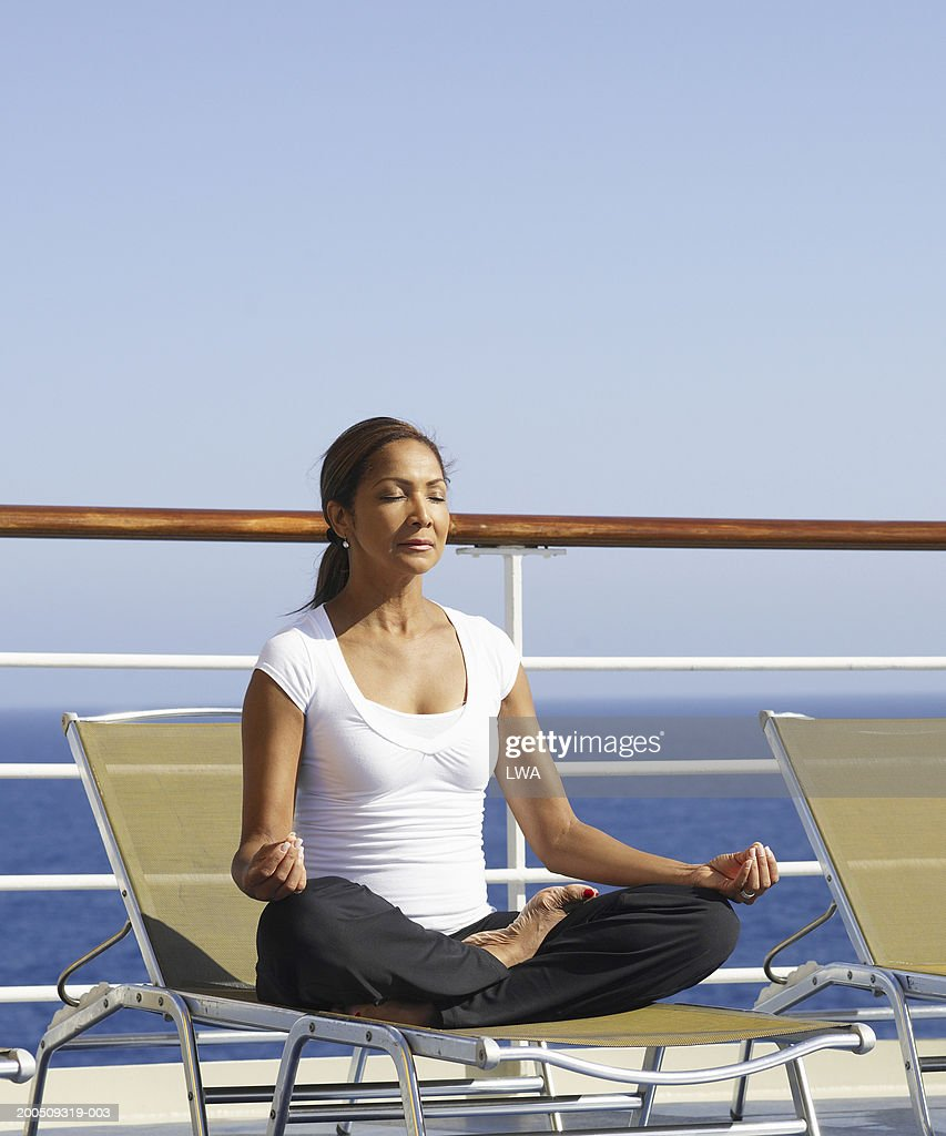 Mature woman doing yoga on cruise