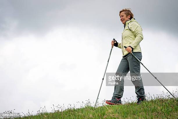 Mature Woman Nordic Walking on Plateau, Slovenia, Europe