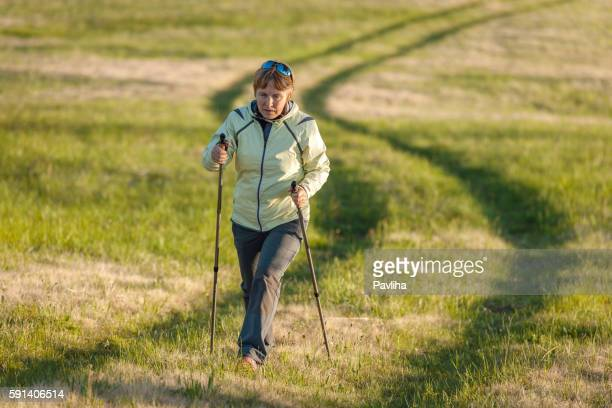mature woman nordic walking on plateau, slovenia, europe - northern european descent stock pictures, royalty-free photos & images
