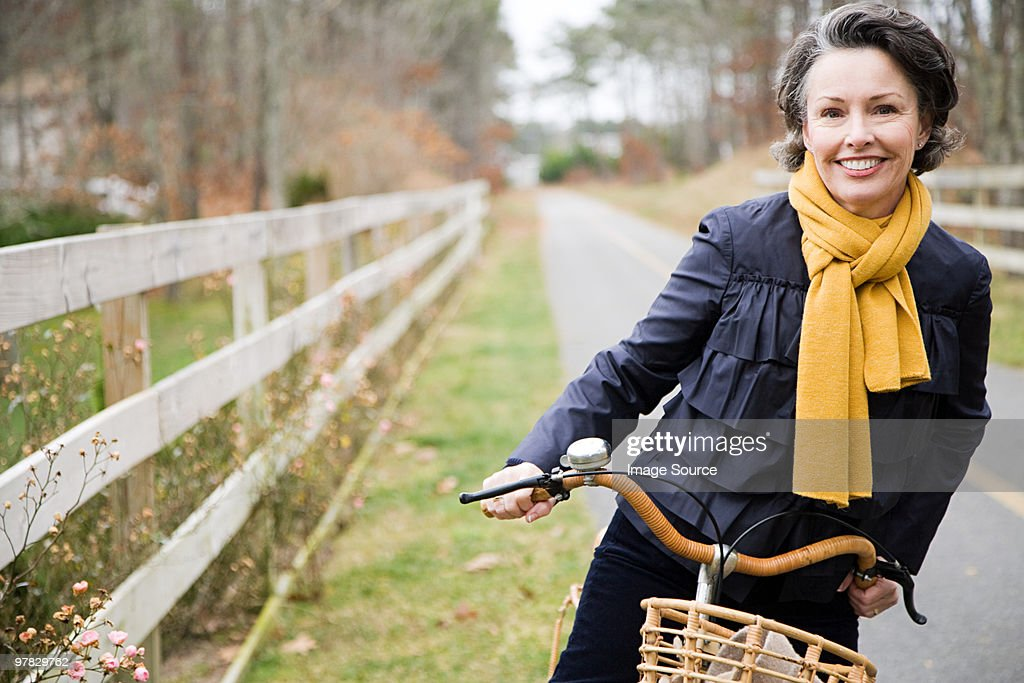 Mature woman on a bicycle : Stock Photo