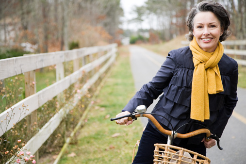 Mature woman on a bicycle - gettyimageskorea