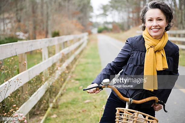 mature woman on a bicycle - baby boomer stock pictures, royalty-free photos & images