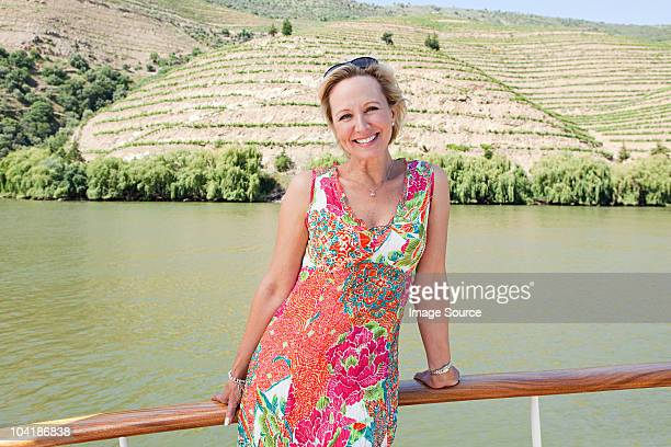 mature woman on a boat holiday - sundress stock pictures, royalty-free photos & images