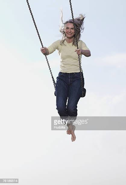 A mature woman on a swing
