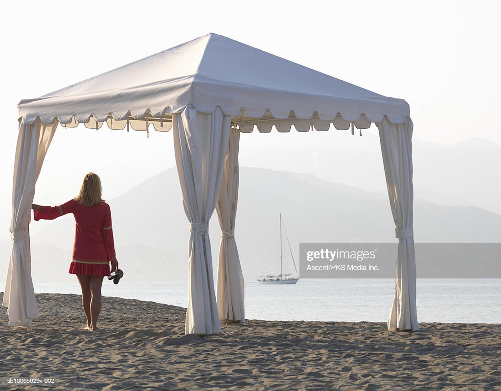 Mature woman on beach looking at view : ストックフォト