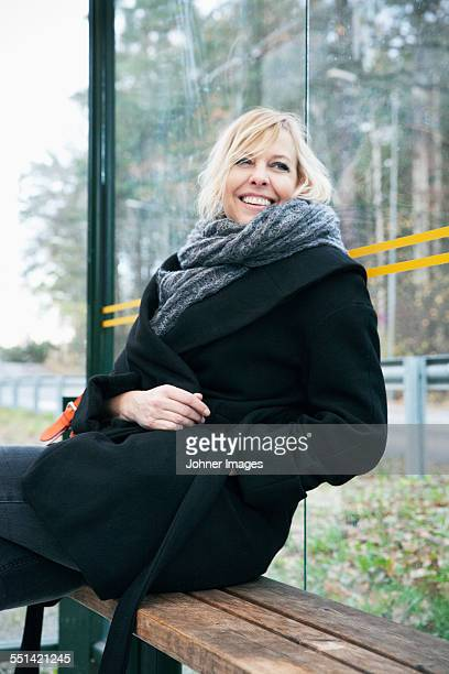 Mature woman on bus stop