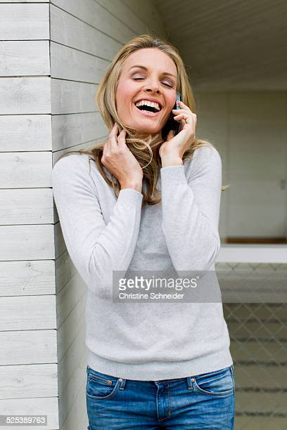 Mature woman on cell phone, laughing