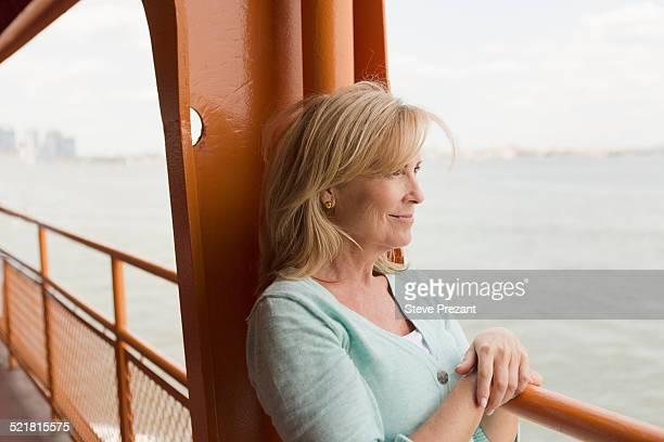 mature woman on passenger ferry - bac photos et images de collection