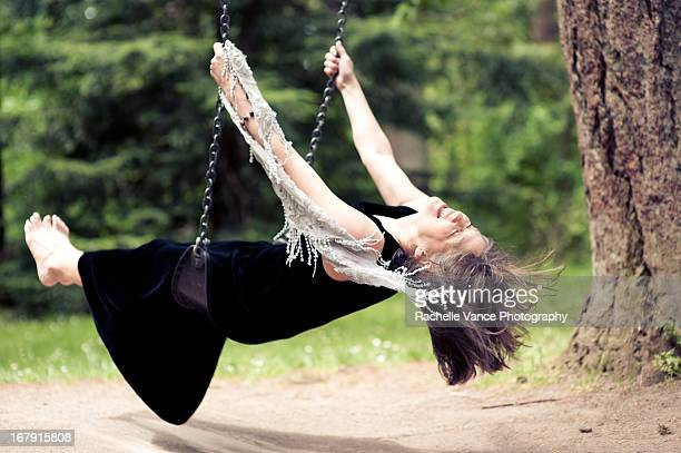 Mature woman on swing in park