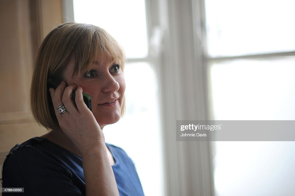 A mature woman on the phone : Stock Photo