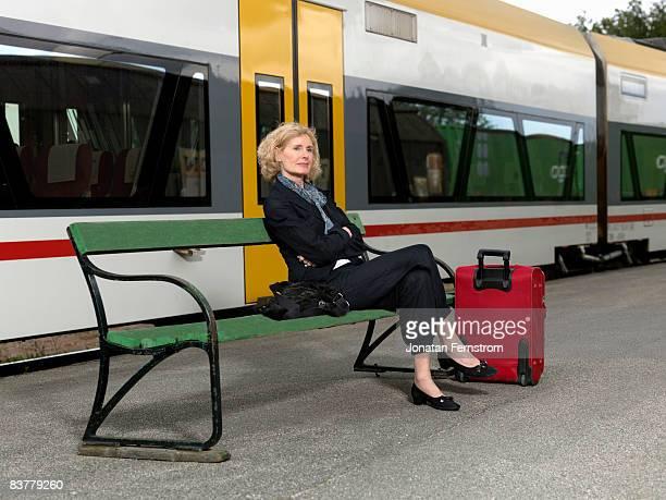 Mature woman on train station