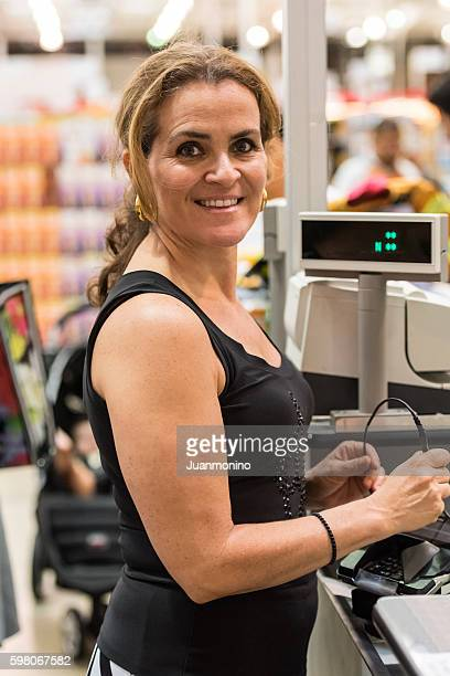 Mature woman paying at the cashier