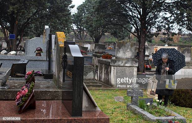 Mature woman paying respects at tombstone