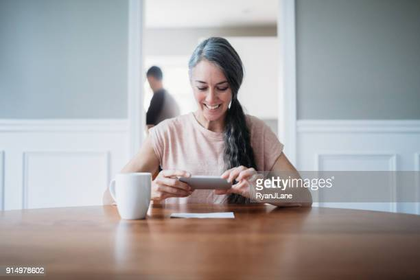 Mature Woman Photographing Check for Remote Deposit