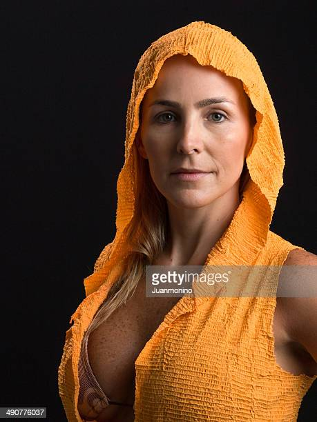 mature woman - hood clothing stock photos and pictures