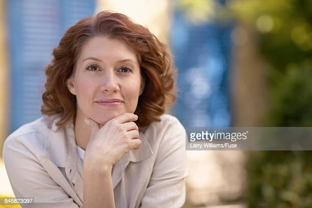mature woman - hand on chin stock pictures, royalty-free photos & images