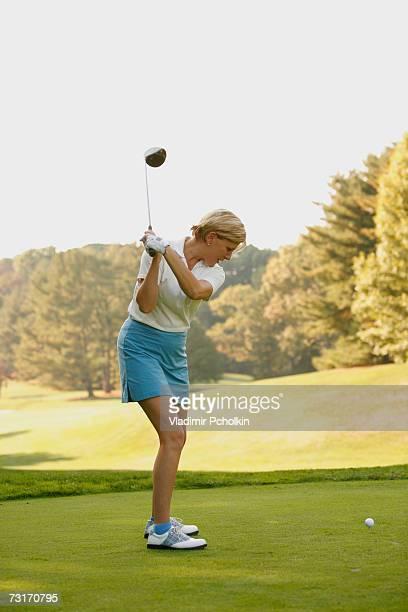 Mature woman playing golf