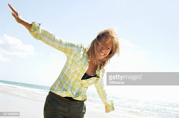 Mature woman playing in the beach