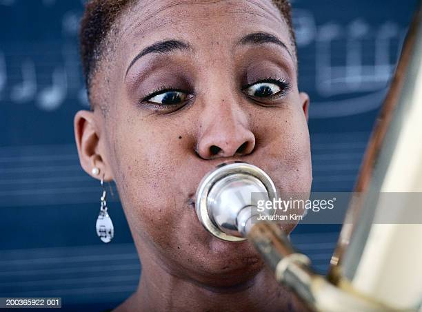 Mature woman playing tuba, close-up