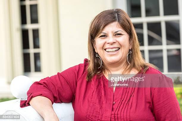 Mature woman posing at her home frontyard
