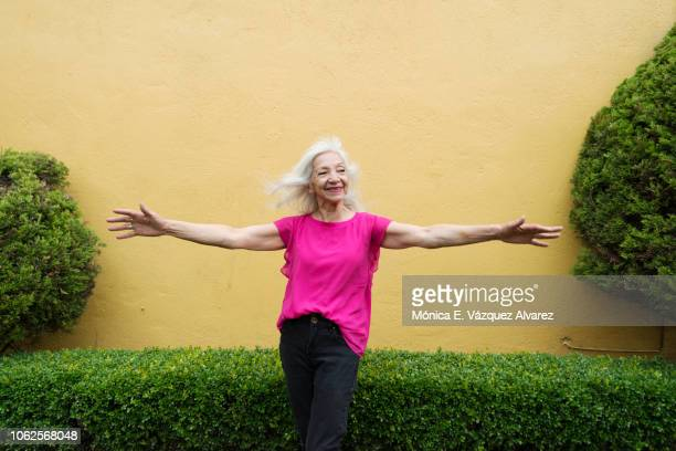 Mature woman posing in a garden