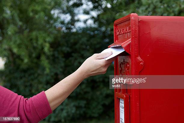 Mature woman posting a letter