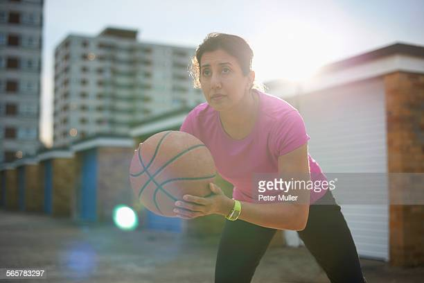 mature woman practicing basketball at dusk - older woman bending over stock pictures, royalty-free photos & images