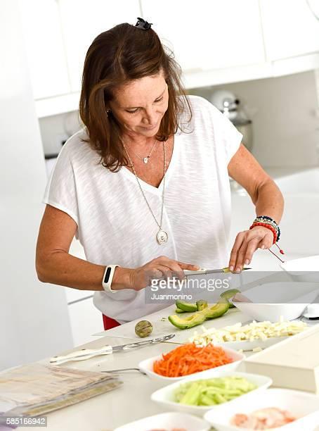 Mature woman preparing food at the kitchen