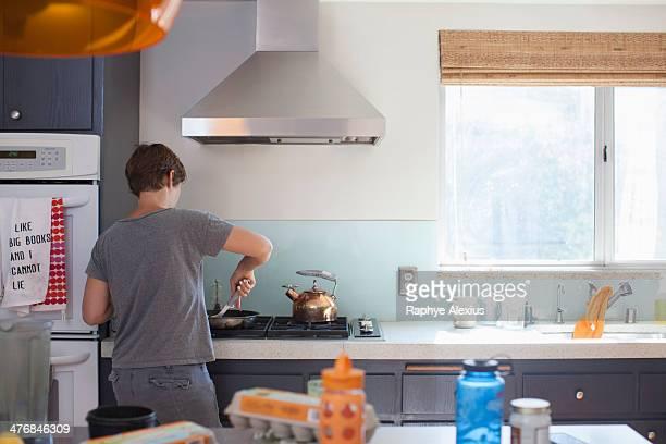 Mature woman preparing food in kitchen