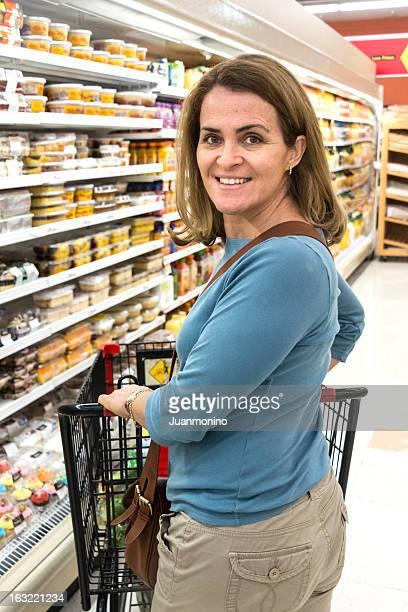 Mature woman pushing her shopping cart