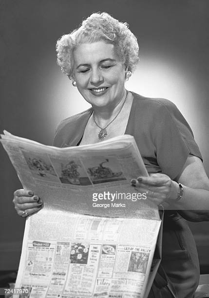 mature woman reading newspaper (b&w) - man made age stock pictures, royalty-free photos & images