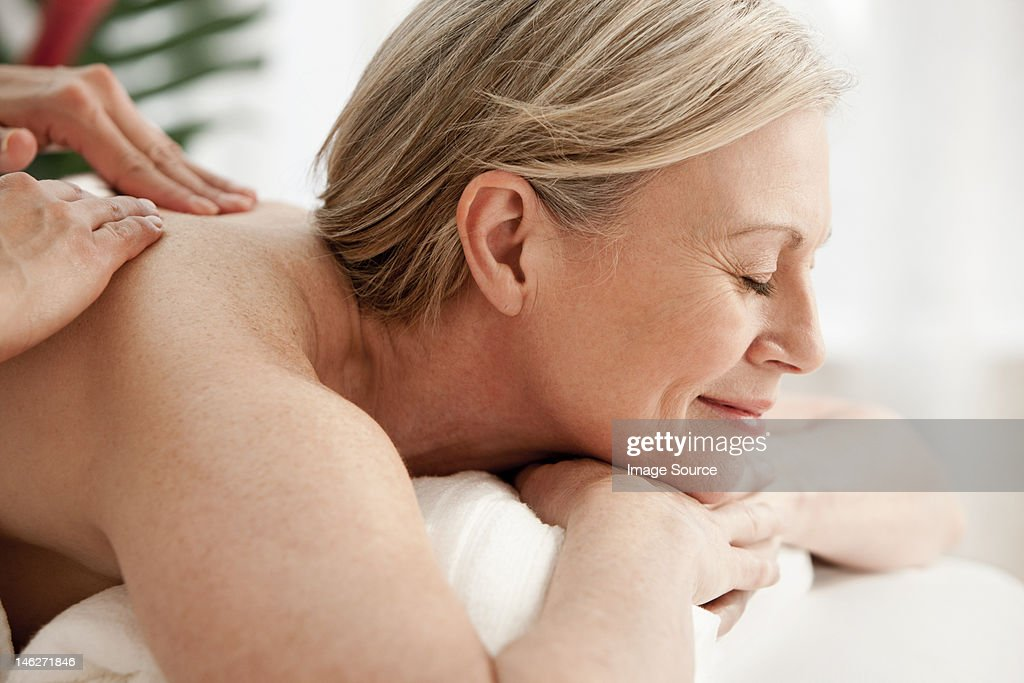 Mature woman receiving massage : Stock Photo
