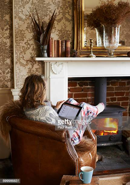 mature woman relaxed in front of fire