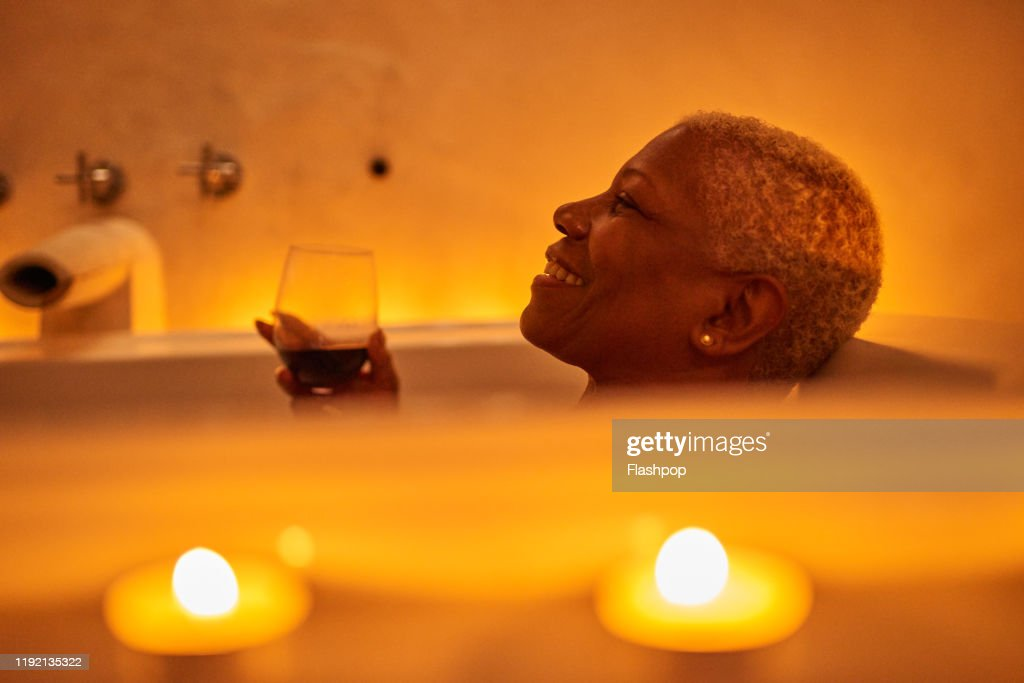 Mature woman relaxes in bath : Stock Photo