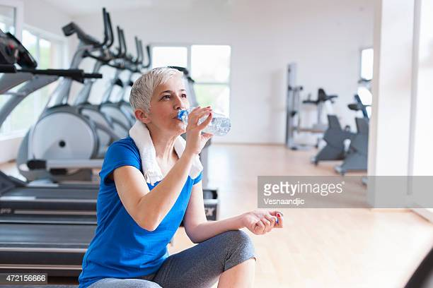 Mature woman relaxing after exercise