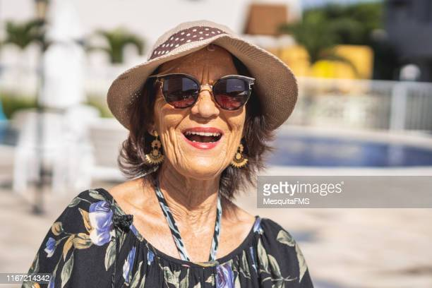 mature woman relaxing at resort hotel - uv protection stock pictures, royalty-free photos & images