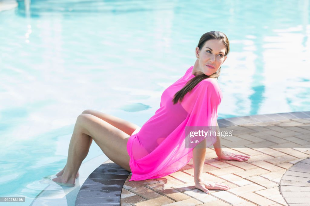 Mature Woman Relaxing By Swimming Pool Feet In Water Stock Photo Getty Images