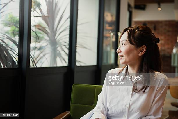 Mature woman relaxing in a cafe