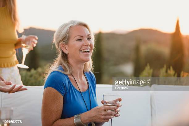 mature woman relaxing on holiday - 45 49 years stock pictures, royalty-free photos & images