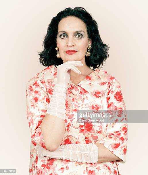 mature woman resting chin on hand, wearing gloves, portrait - evening glove stock pictures, royalty-free photos & images