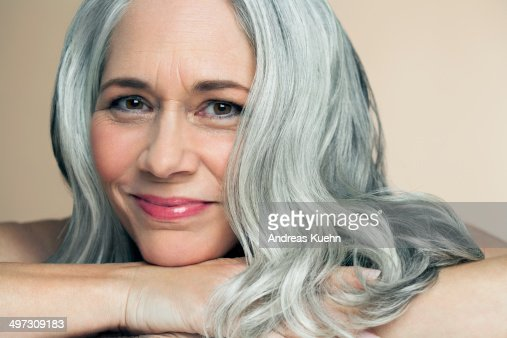 Mature Woman Resting Chin On Her Wrist Portrait Stock Photo  Getty Images-8637