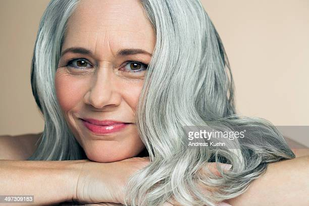 Mature woman resting chin on her wrist, portrait.