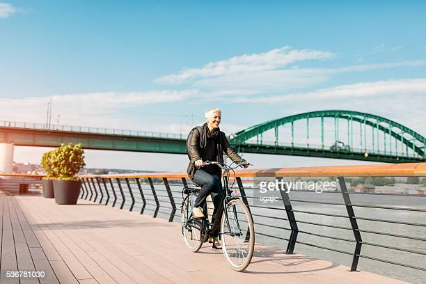 Mature Woman Riding Bicycle.