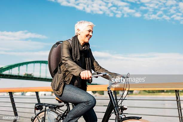 Mature Woman Riding  Her Bicycle.