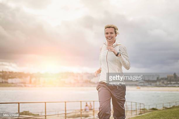 Mature woman running in Bondi beach