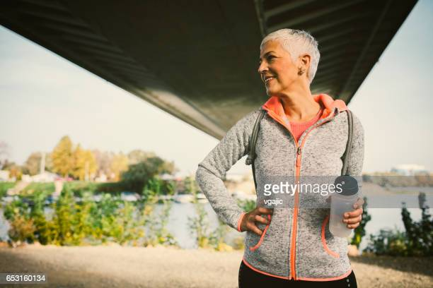 Mature Woman Running In The City