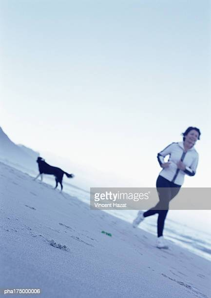 Mature woman running on beach