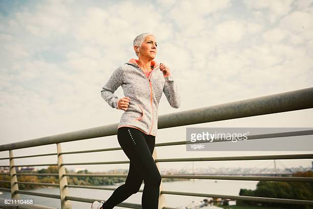 Mature Woman Running The City