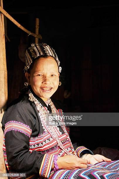 Mature woman sewing, portrait